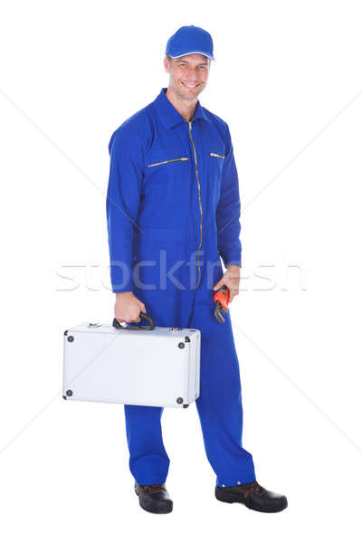 Happy Worker Holding Toolkit And Wrench Stock photo © AndreyPopov