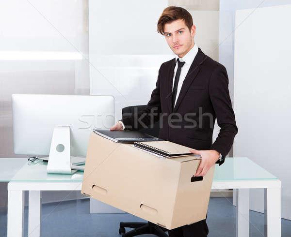 Businessman Holding Box Stock photo © AndreyPopov
