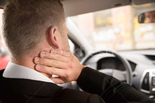 Man Suffering From Neck Pain While Driving Stock photo © AndreyPopov