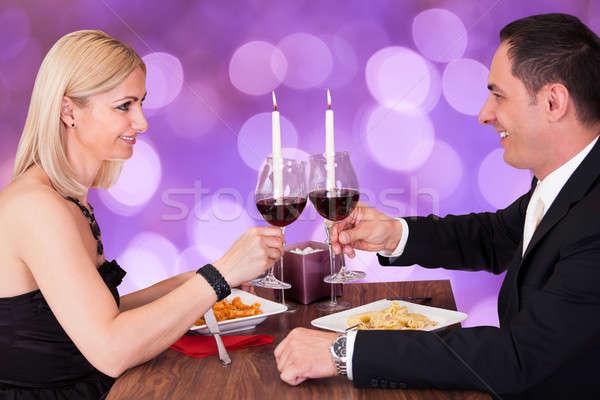 Romantic Couple Toasting Wineglasses In Restaurant Stock photo © AndreyPopov