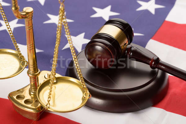 Justice Scale And Wood Gavel On Usa Flag Stock photo © AndreyPopov