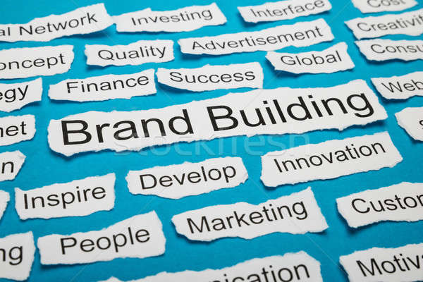 Word Brand Building On Piece Of Torn Paper Stock photo © AndreyPopov