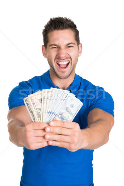Man Screaming While Holding Fanned Us Paper Currency Stock photo © AndreyPopov
