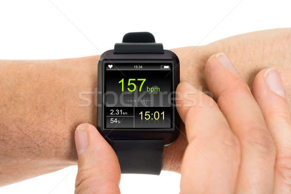 Human Hand With Smartwatch Showing Heartbeat Rate Stock photo © AndreyPopov