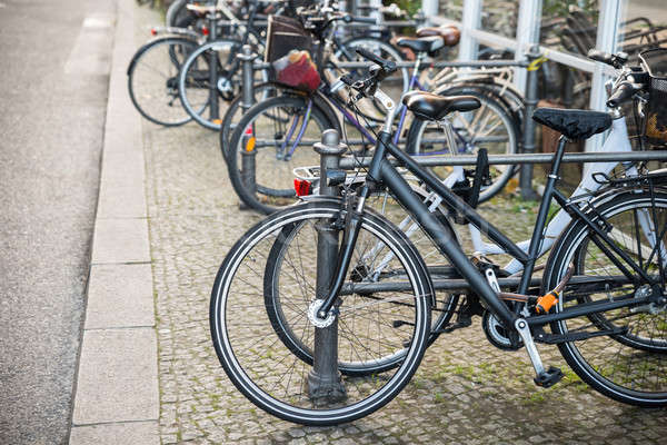 Bicycles Parked Against A Railing Stock photo © AndreyPopov