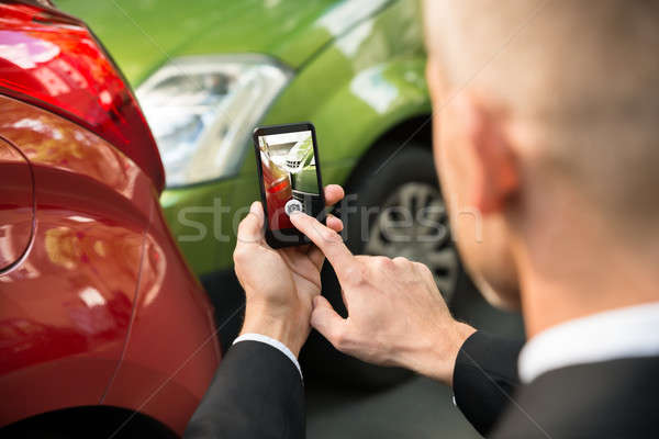 Male Driver Photographing Of Damaged Car Stock photo © AndreyPopov