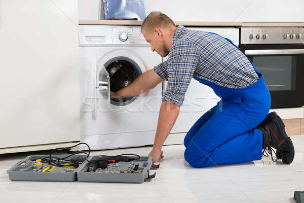 Worker With Toolbox Repairing Washing Machine Stock photo © AndreyPopov