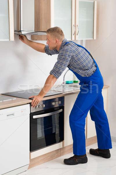 Handyman Fixing Kitchen Extractor Fan Stock photo © AndreyPopov