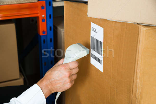 Person Hands With Barcode Scanner Scanning Box Stock photo © AndreyPopov