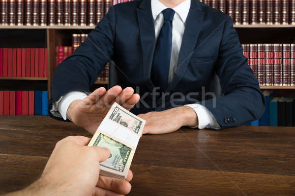 Lawyer Refusing To Take Bribe From Client At Desk Stock photo © AndreyPopov