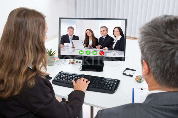 Businesspeople Video Chatting With Colleagues On Computer Stock photo © AndreyPopov