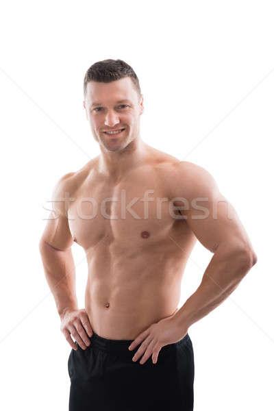 ストックフォト: 幸せ · 筋肉の · 男 · 立って · 手 · ヒップ