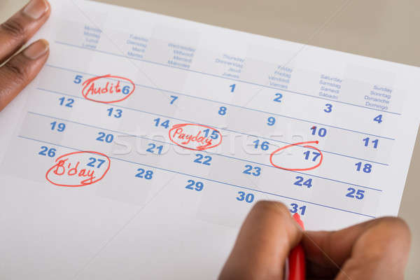 Person Marking Important Date On Calendar Stock photo © AndreyPopov
