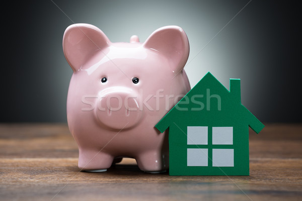 Green Paper House And Piggybank On Table Stock photo © AndreyPopov