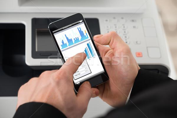 Empresário imprimir comando imagem escritório Foto stock © AndreyPopov