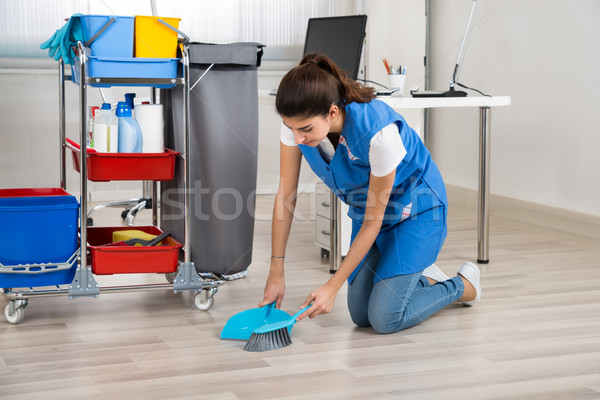 Cleaner Sweeping Floor With Broom And Dustpan In Office Stock photo © AndreyPopov
