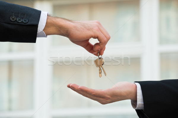 Real Estate Agent Giving House Keys To Businessman Stock photo © AndreyPopov
