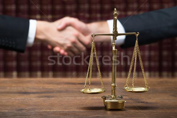 правосудия масштаба таблице судья клиент рукопожатием Сток-фото © AndreyPopov