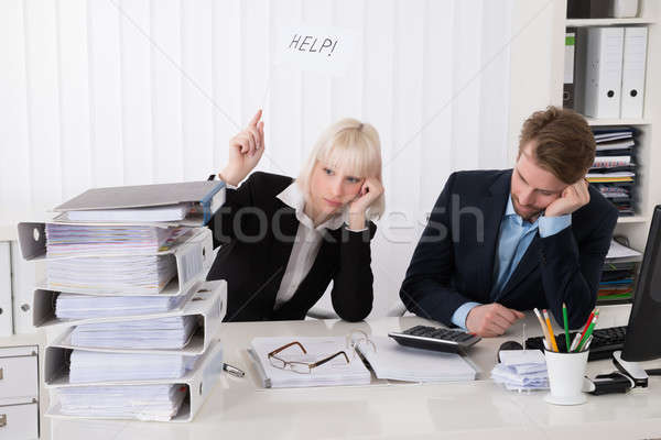 Two Businesspeople Holding White Flag With Help Text Stock photo © AndreyPopov