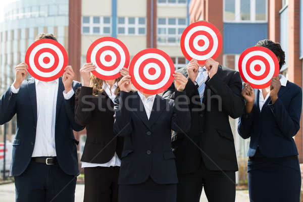 Businesspeople Hiding Face With Dartboard Stock photo © AndreyPopov