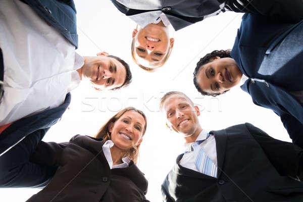 Grup aşağı bakıyor mutlu profesyonel iş Stok fotoğraf © AndreyPopov