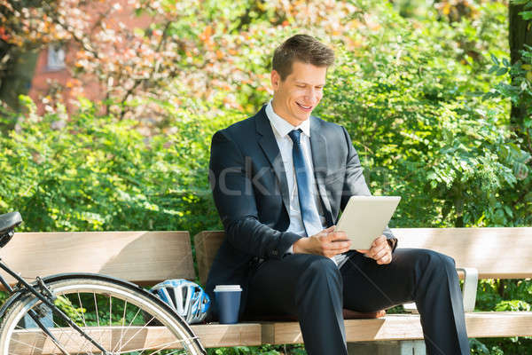 Businessman Sitting On Bench Using Digital Tablet Stock photo © AndreyPopov