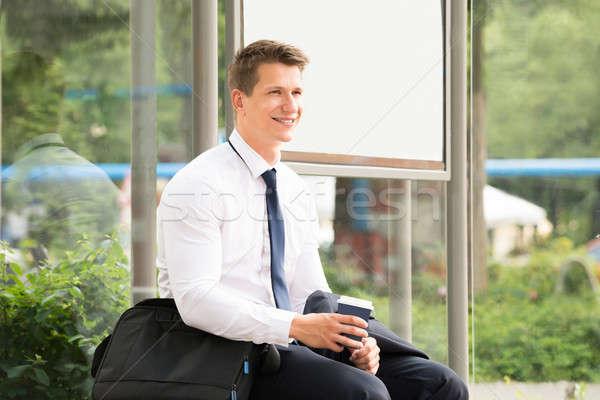 Empresario espera parada de autobús jóvenes trabajo hombre Foto stock © AndreyPopov