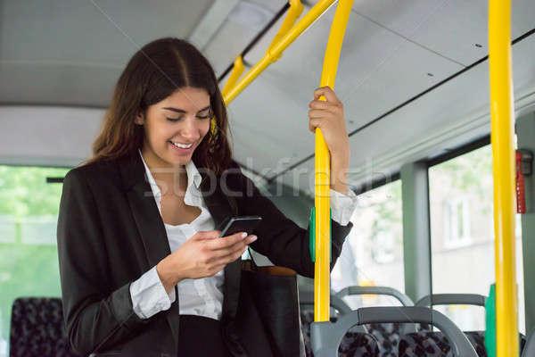 Empresária jovem sorridente transporte público Foto stock © AndreyPopov