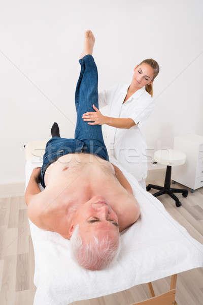 Masseur Giving Leg Massage To Man Stock photo © AndreyPopov