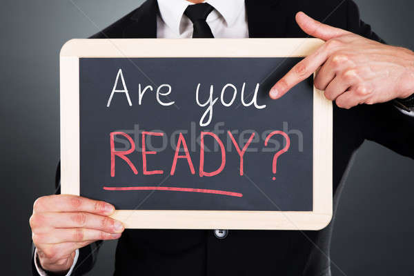 Businessman Showing Are You Ready Text On Slate Stock photo © AndreyPopov