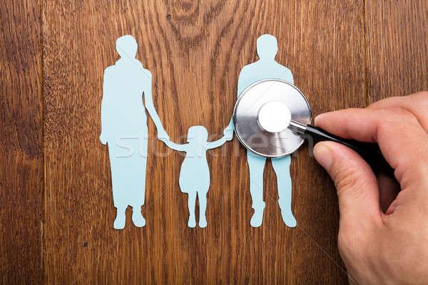 Stethoscope On Family Papercut Stock photo © AndreyPopov