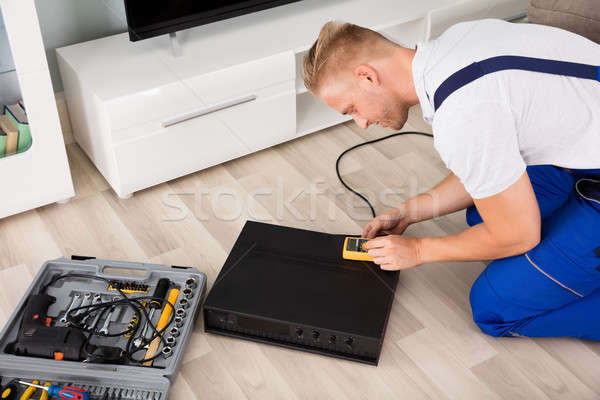 Technician Checking Amplifier Stock photo © AndreyPopov