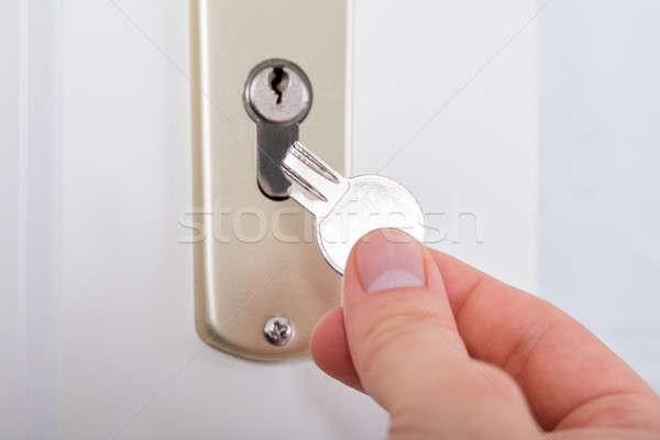 Person's Hand Holding Broken Key Stock photo © AndreyPopov