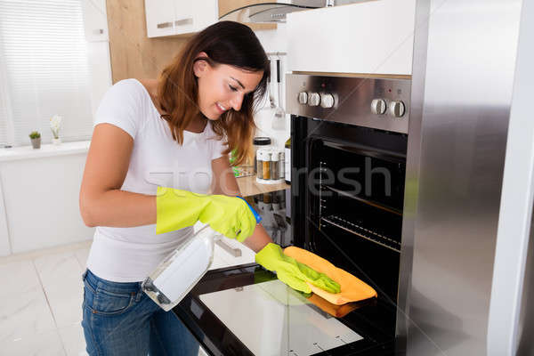 Woman Cleaning The Oven In Kitchen Stock photo © AndreyPopov