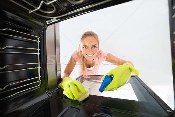 Woman Cleaning Inside The Oven Stock photo © AndreyPopov