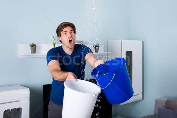 Man Holding Bucket Stock photo © AndreyPopov