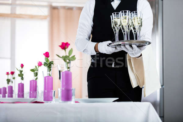 Waiter Standing With Champagne Glasses Stock photo © AndreyPopov