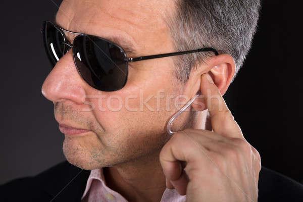 Erkek güvenlik görevlisi dinleme el adam Stok fotoğraf © AndreyPopov