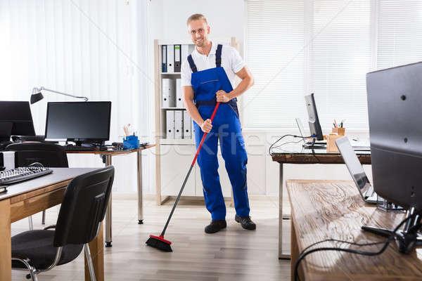 мужчины очистки полу метлой улыбаясь Сток-фото © AndreyPopov