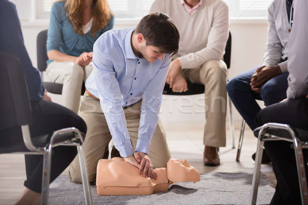 Male Instructor Showing CPR Training On Dummy Stock photo © AndreyPopov