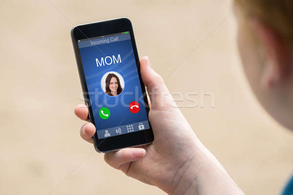 Mom's Incoming Call On Smartphone Stock photo © AndreyPopov
