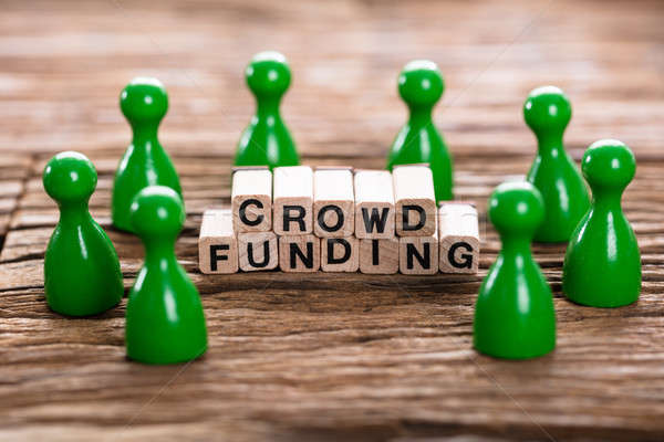 Crowd Funding Word Made With Wooden Blocks Stock photo © AndreyPopov