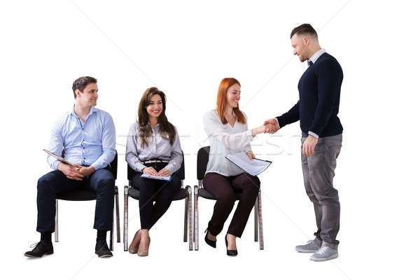 Businessman Welcoming People Waiting For Interview Stock photo © AndreyPopov