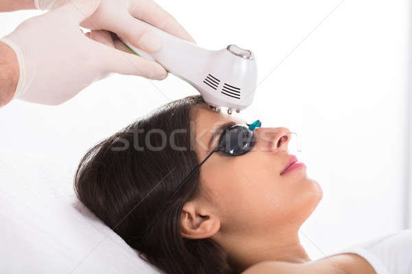 Woman Getting A Ultrasound Skin Treatment Stock photo © AndreyPopov