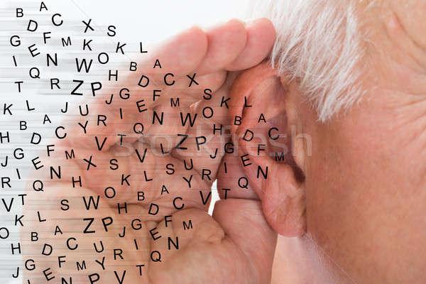 Mann halten Hand Ohr hören vorsichtig Stock foto © AndreyPopov