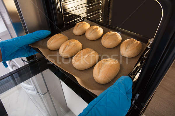 Person Holding Tray Of Baked Bread Stock photo © AndreyPopov