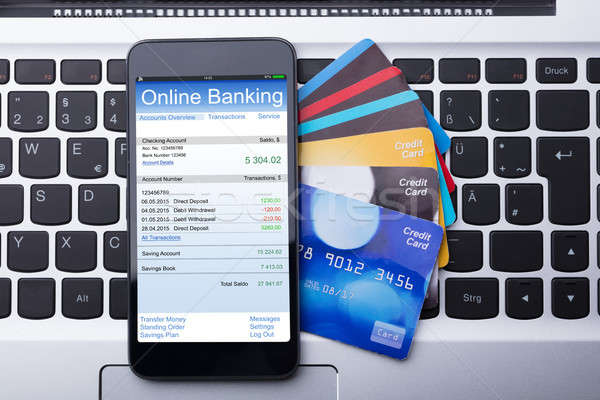 Mobilephone With Online Banking App Stock photo © AndreyPopov