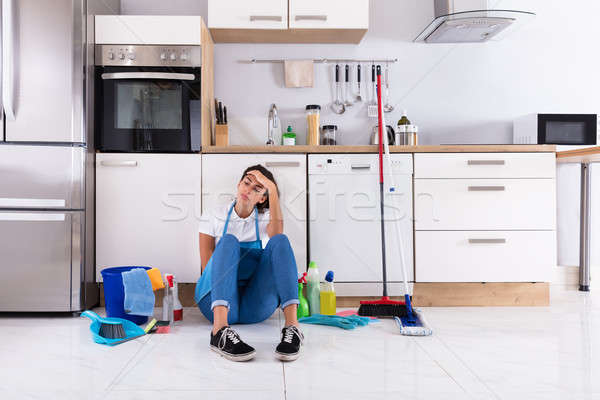 Young Woman Sitting On Kitchen Floor Stock photo © AndreyPopov
