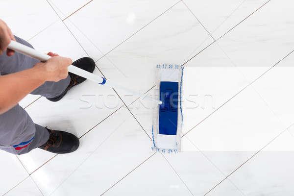 Worker Mopping Floor Stock photo © AndreyPopov