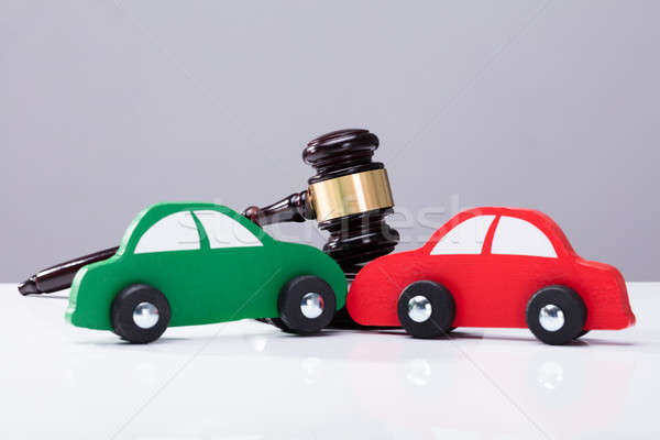 Green And Red Car In Front Of Gavel Stock photo © AndreyPopov